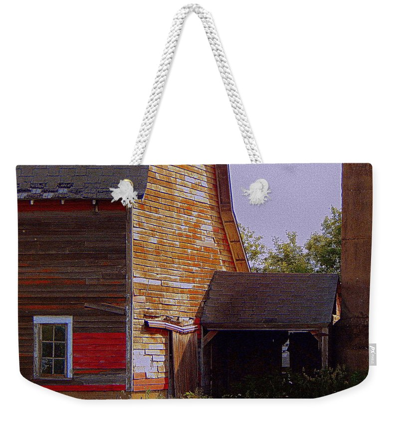 Barn Weekender Tote Bag featuring the photograph An Old Barn And Silo by Curtis Tilleraas