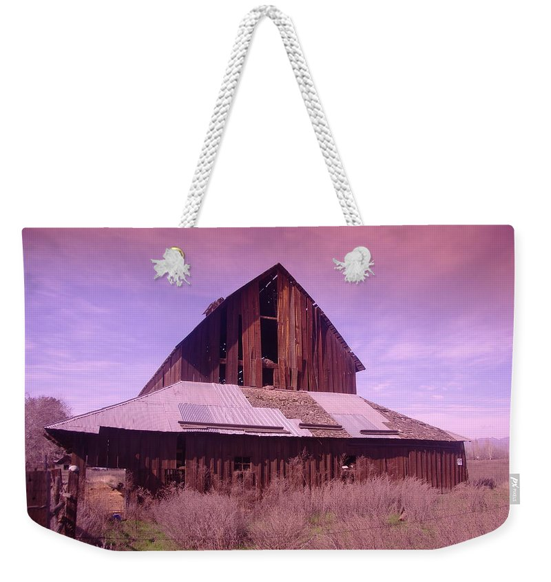 Barns Weekender Tote Bag featuring the photograph An Old Weathered Barn by Jeff Swan