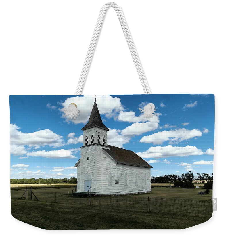 Church Weekender Tote Bag featuring the photograph An Old Wooden Church by Jeff Swan