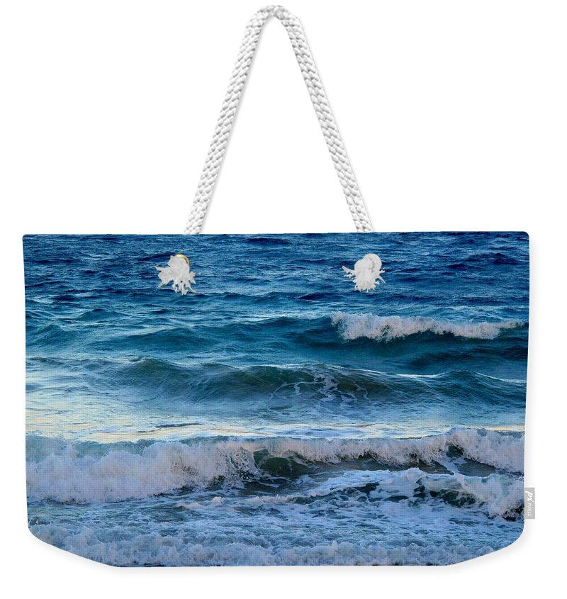 Sea Weekender Tote Bag featuring the photograph An Unforgiving Sea by Ian MacDonald