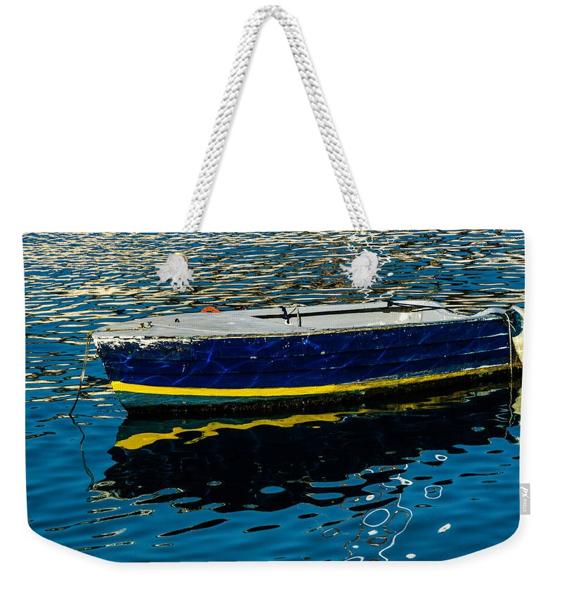 Boat Weekender Tote Bag featuring the photograph Anchored Boat by Wolfgang Stocker
