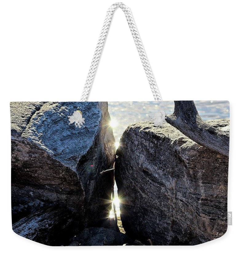 Washington Harbor Weekender Tote Bag featuring the photograph And A Hard Place by Tyquill Williams