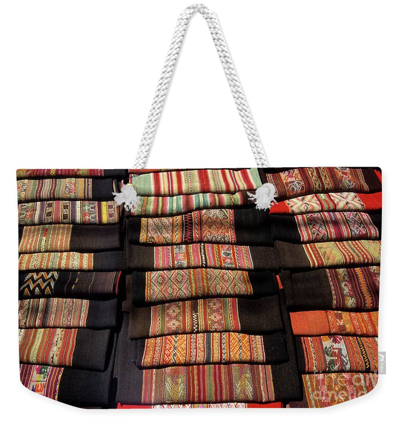 Bolivia Weekender Tote Bag featuring the photograph Andean Textile Market by James Brunker