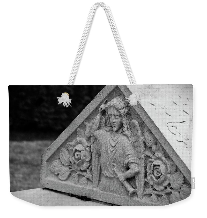 Ireland Weekender Tote Bag featuring the photograph Angel With Horn Carving by Teresa Mucha