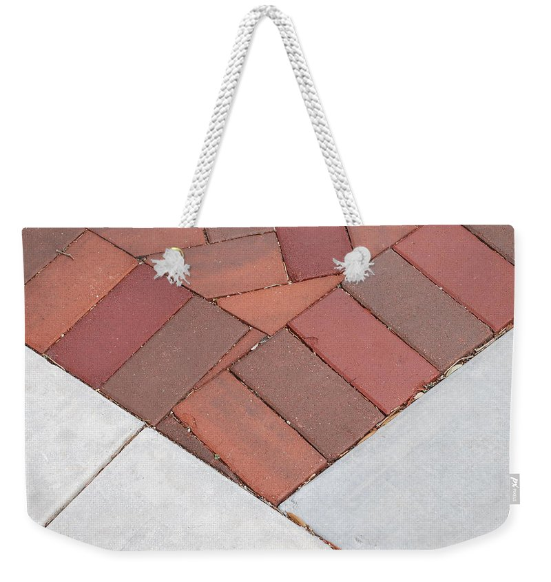 Bricks Weekender Tote Bag featuring the photograph Angles by Rob Hans