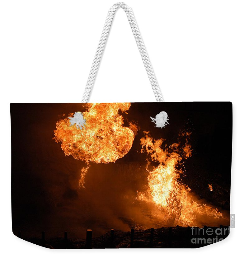 Clay Weekender Tote Bag featuring the photograph Angry Face by Clayton Bruster