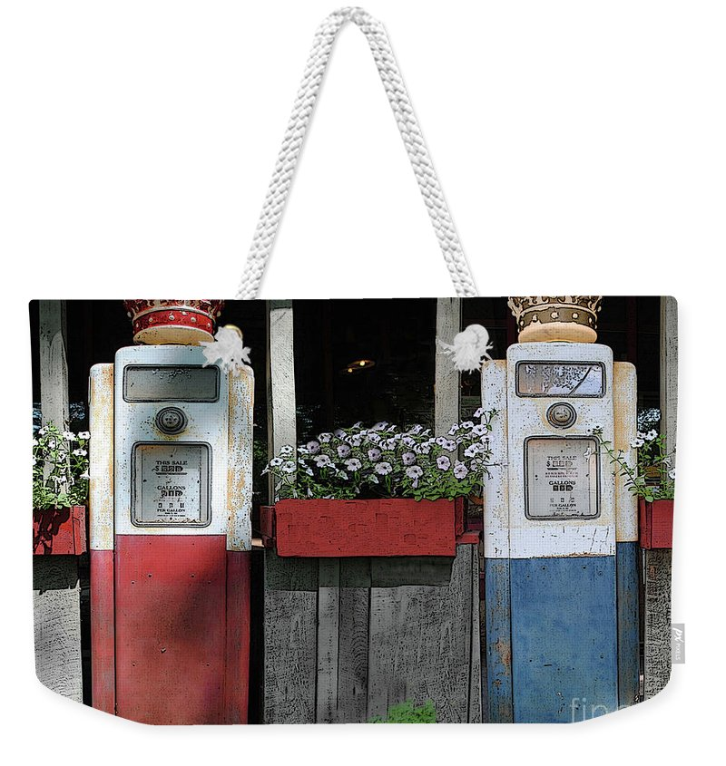 Antigue Weekender Tote Bag featuring the photograph Antique Gas Pumps by Jost Houk