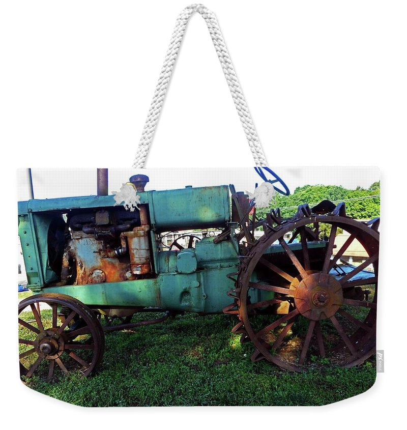 Hurricane Mills Weekender Tote Bag featuring the photograph Antique Tractor 1 by Ron Kandt