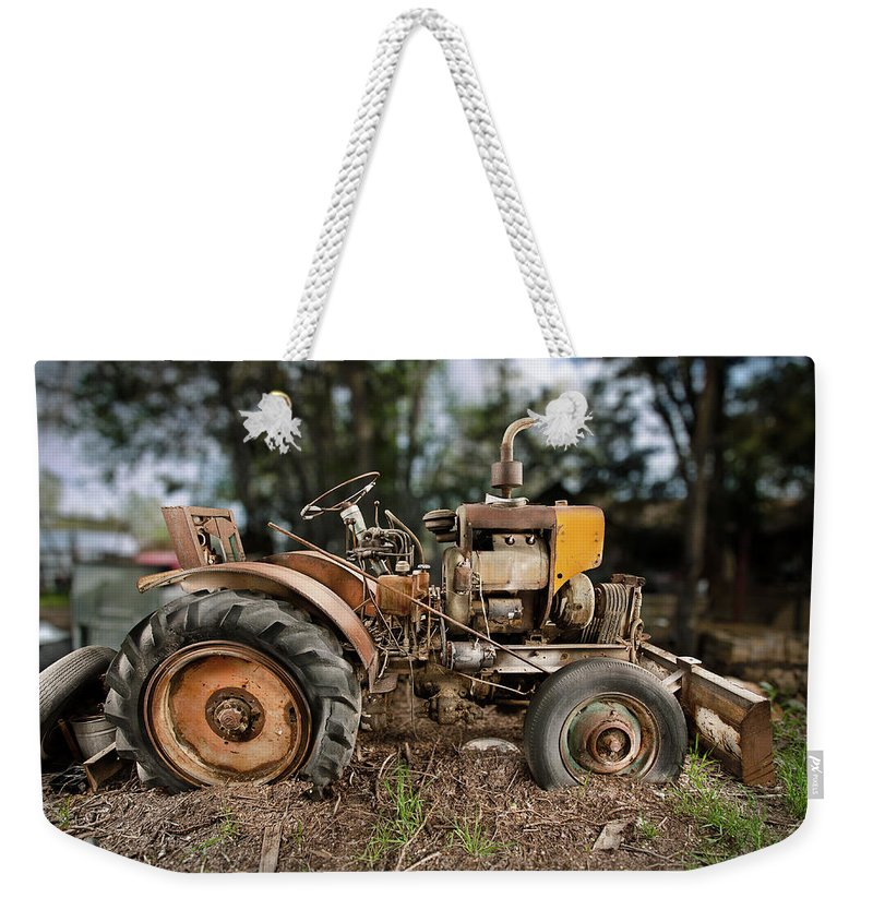 Antique Weekender Tote Bag featuring the photograph Antique Tractor by Yo Pedro