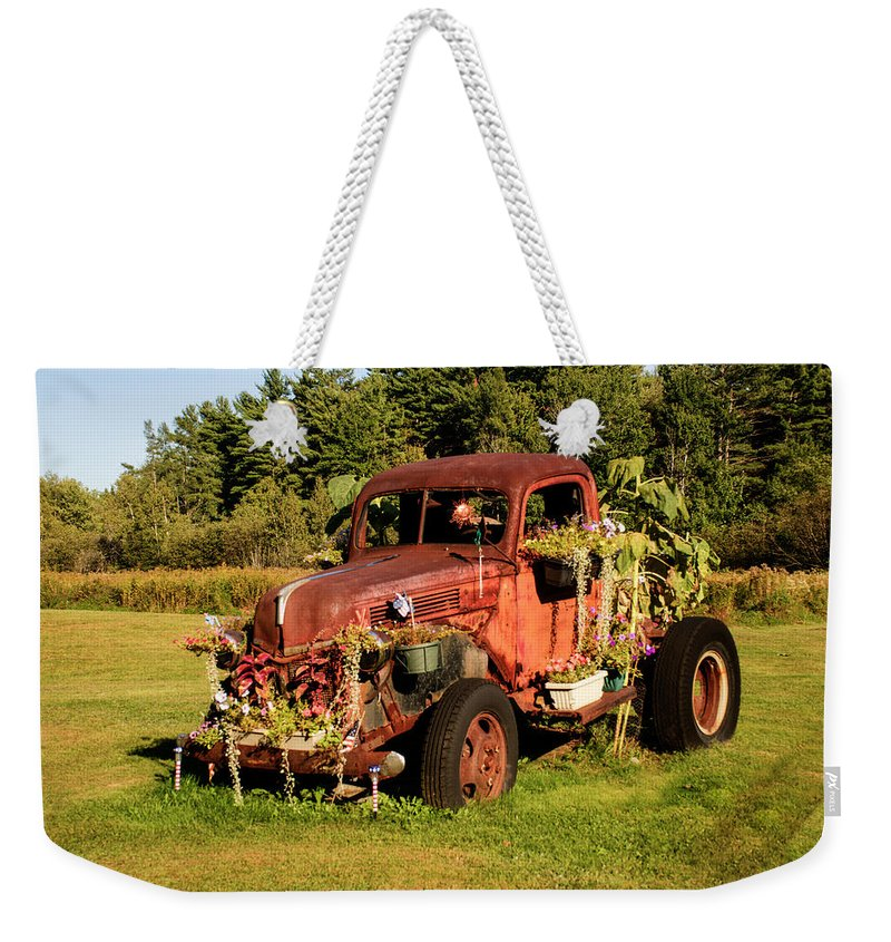 Emotion Weekender Tote Bag featuring the photograph Antique Vehicle As A Planter by Douglas Barnett