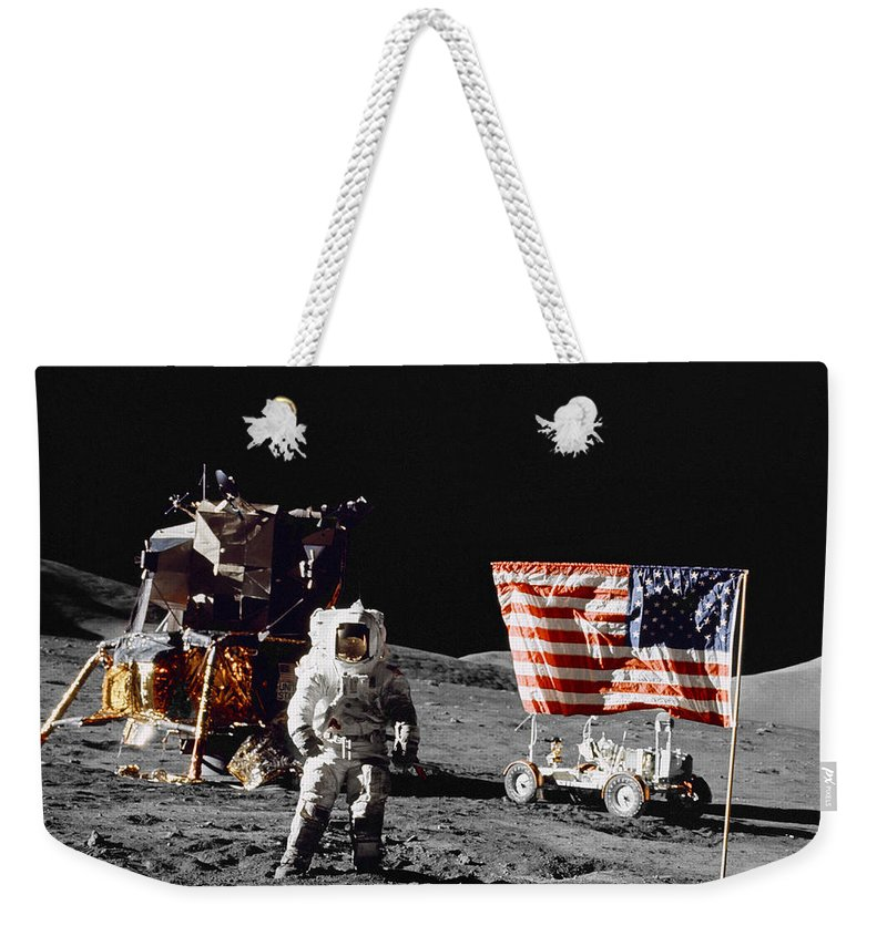1972 Weekender Tote Bag featuring the photograph Apollo 17 Astronaut Stands by Stocktrek Images