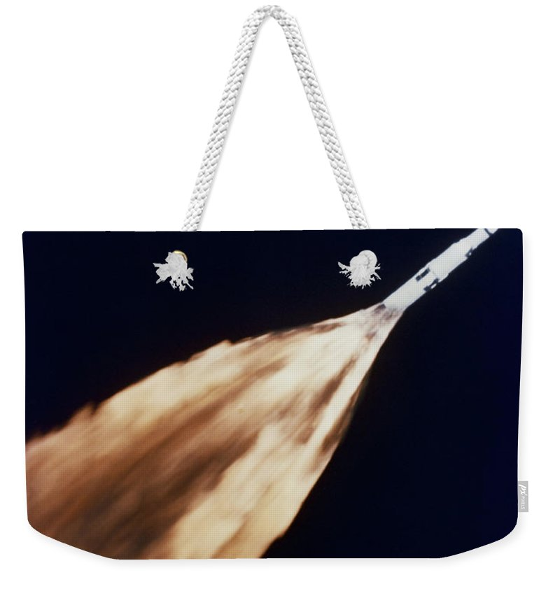 1968 Weekender Tote Bag featuring the photograph Apollo 6 Spacecraft Leaves A Fiery by Stocktrek Images