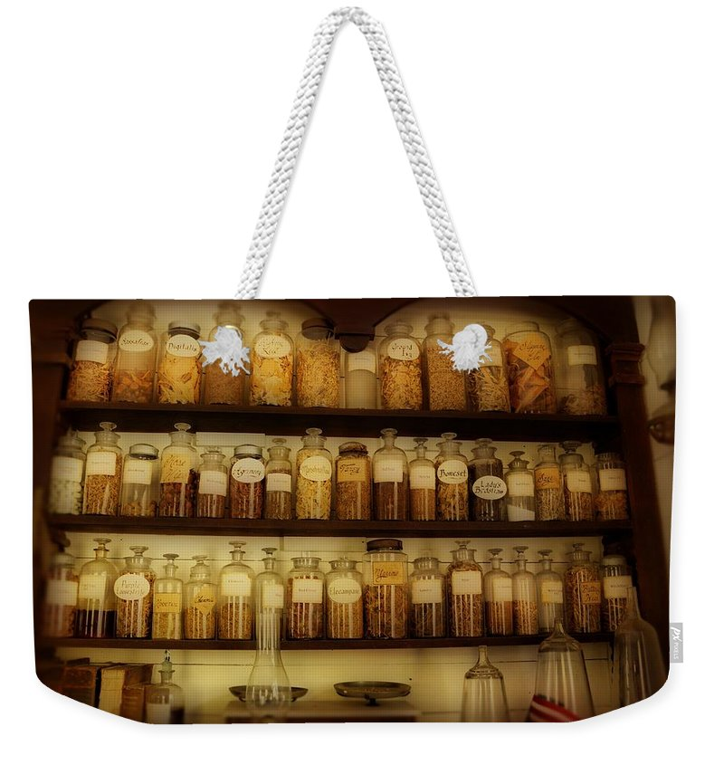 Apothecary Jars Weekender Tote Bag featuring the photograph Apothecary Jars by Sandy Keeton