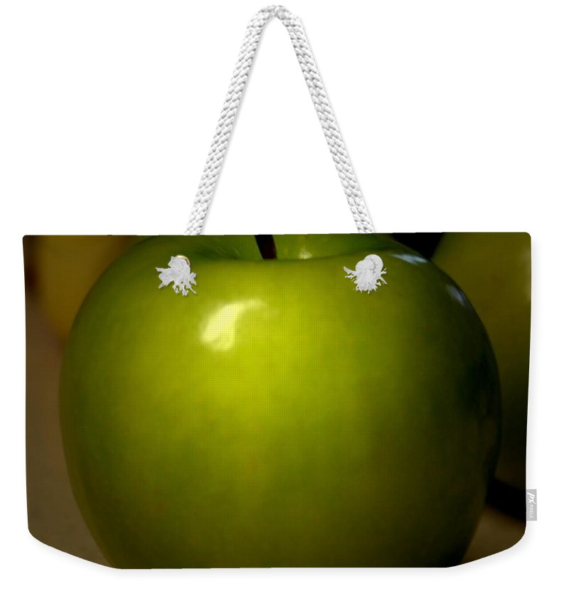 Green Apples Weekender Tote Bag featuring the photograph Apple by Linda Sannuti
