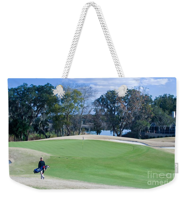 Golf Weekender Tote Bag featuring the photograph Approaching The 18th Green by Thomas Marchessault