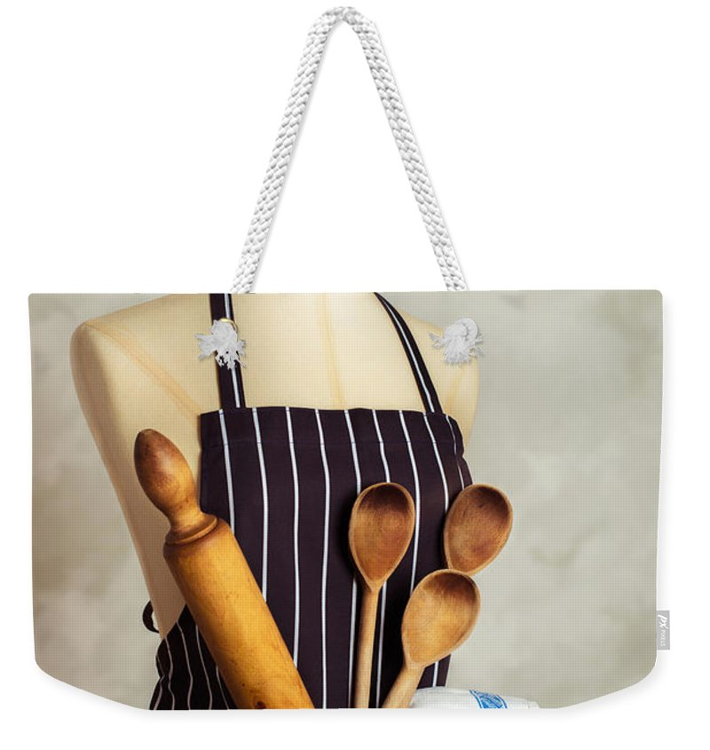 Baking Weekender Tote Bag featuring the photograph Apron With Utensils by Amanda Elwell