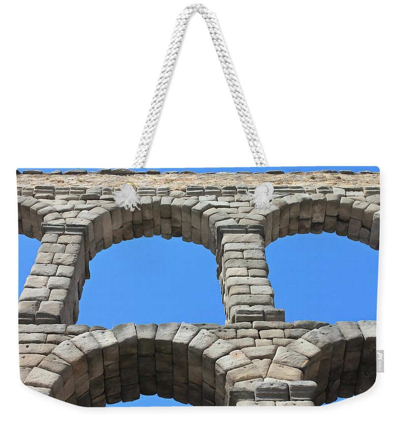 Aqueduct Of Segovia Weekender Tote Bag featuring the photograph Aqueduct Of Segovia by Sergey Lukashin