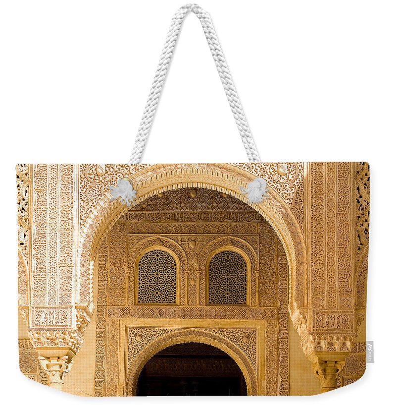 Cuarto Weekender Tote Bag featuring the photograph Arabesque Ornamental Designs At The Casa Real In The Nasrid Palaces At The Alhambra by Mal Bray
