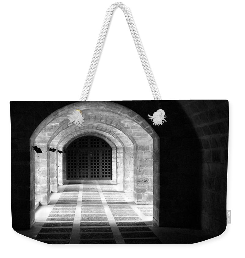 Landscape Weekender Tote Bag featuring the photograph Arched Hallway In Palma by Donna Corless