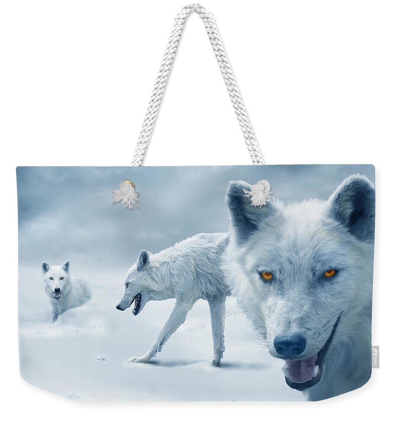 Arctic Weekender Tote Bag featuring the photograph Arctic Wolves by Mal Bray