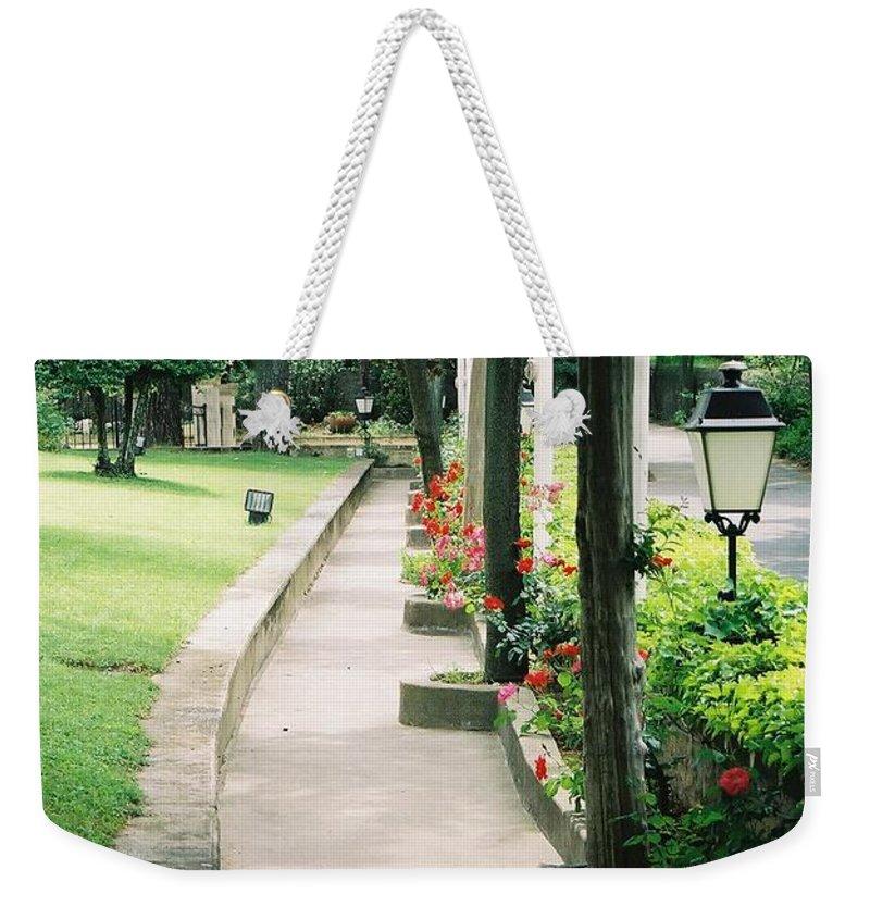 Arles Weekender Tote Bag featuring the photograph Arles Walkway by Nadine Rippelmeyer
