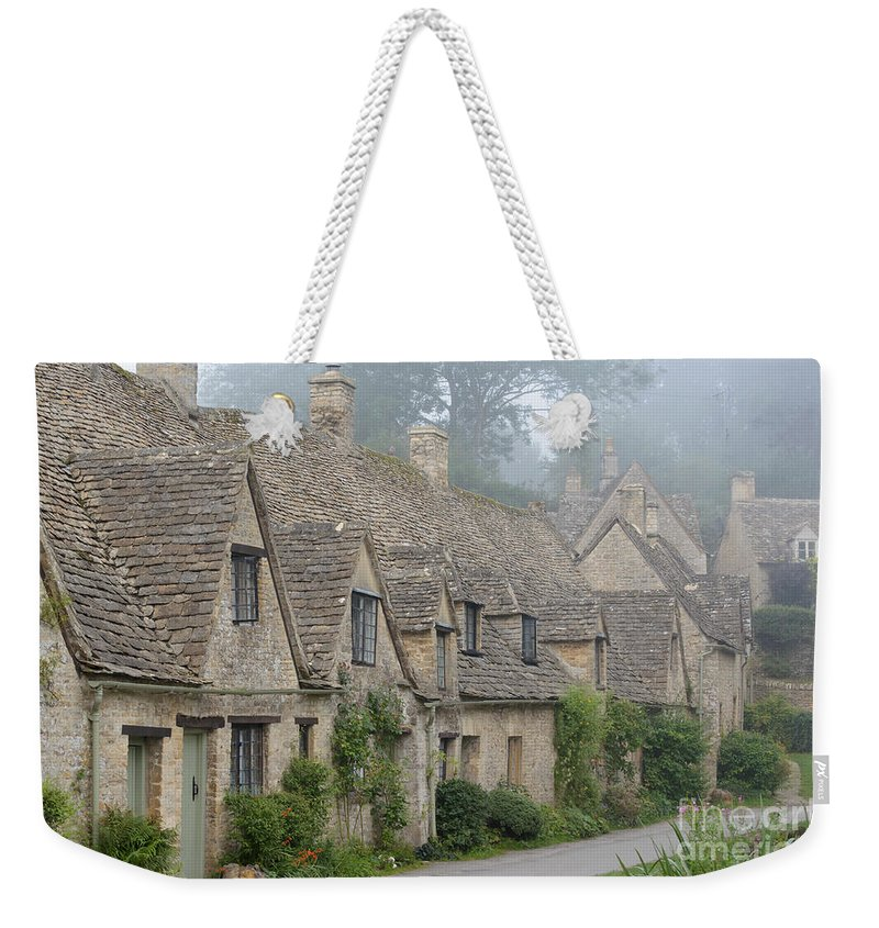 Arlington Row Weekender Tote Bag featuring the photograph Arlington Row, Bibury In The Morning Fog by IPics Photography
