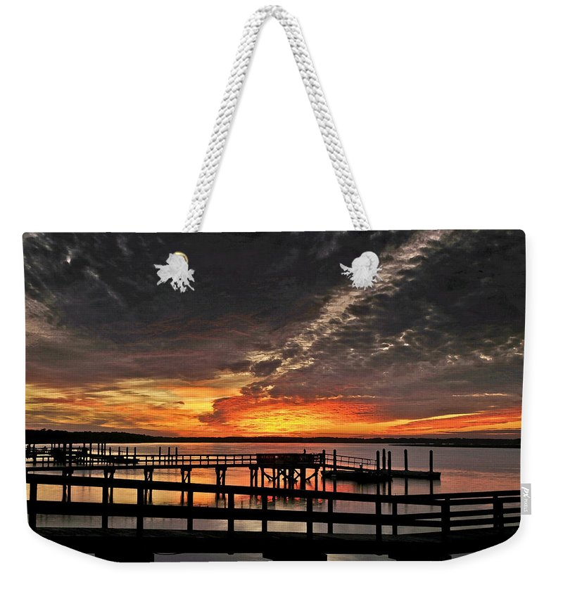 Sunset Weekender Tote Bag featuring the photograph Artistic Black Sunset by Phill Doherty