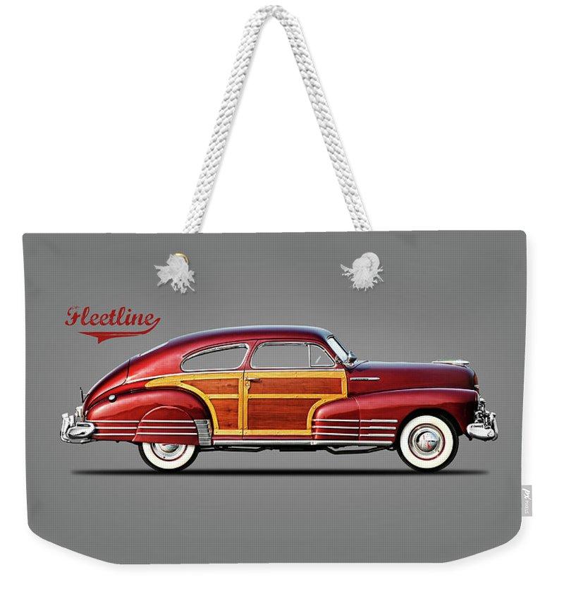 Chevrolet Fleetline Weekender Tote Bag featuring the photograph Chevrolet Fleetline 1948 by Mark Rogan