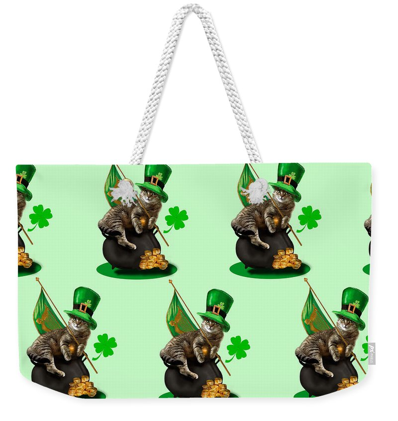 Humorous Holliday St. Patrick's Day Irish Cat Weekender Tote Bag featuring the painting St. Patrick's day Irish cat sitting on a pot of gold by Regina Femrite