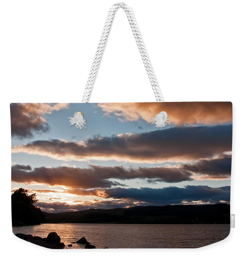 Clouds Weekender Tote Bag featuring the photograph As The Sun Sets Over Loch Rannoch by Bel Menpes