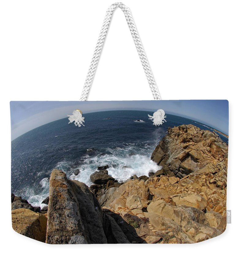 Ocean Weekender Tote Bag featuring the photograph As The World Turns by Donna Blackhall