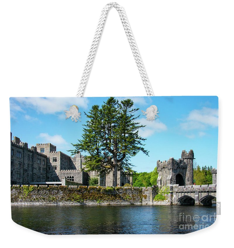 Cong Weekender Tote Bag featuring the photograph Ashford Castle And Cong River by Bob Phillips