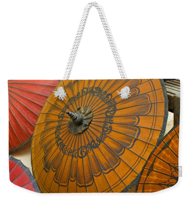Oriental Weekender Tote Bag featuring the photograph Asian Umbrellas by Michele Burgess