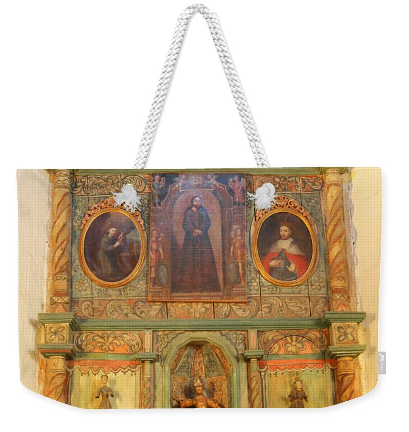 Alter Weekender Tote Bag featuring the photograph At The Alter San Miguel Mission Santa Fe New Mexico by Jeff Swan