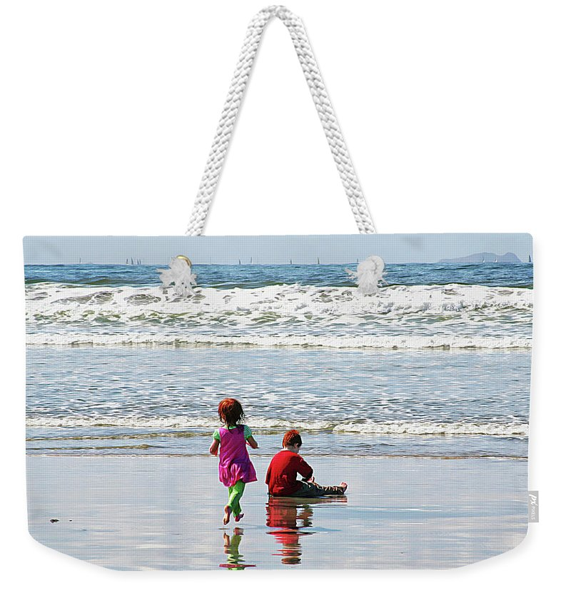 Siblings Weekender Tote Bag featuring the photograph At The Beach by Margie Wildblood
