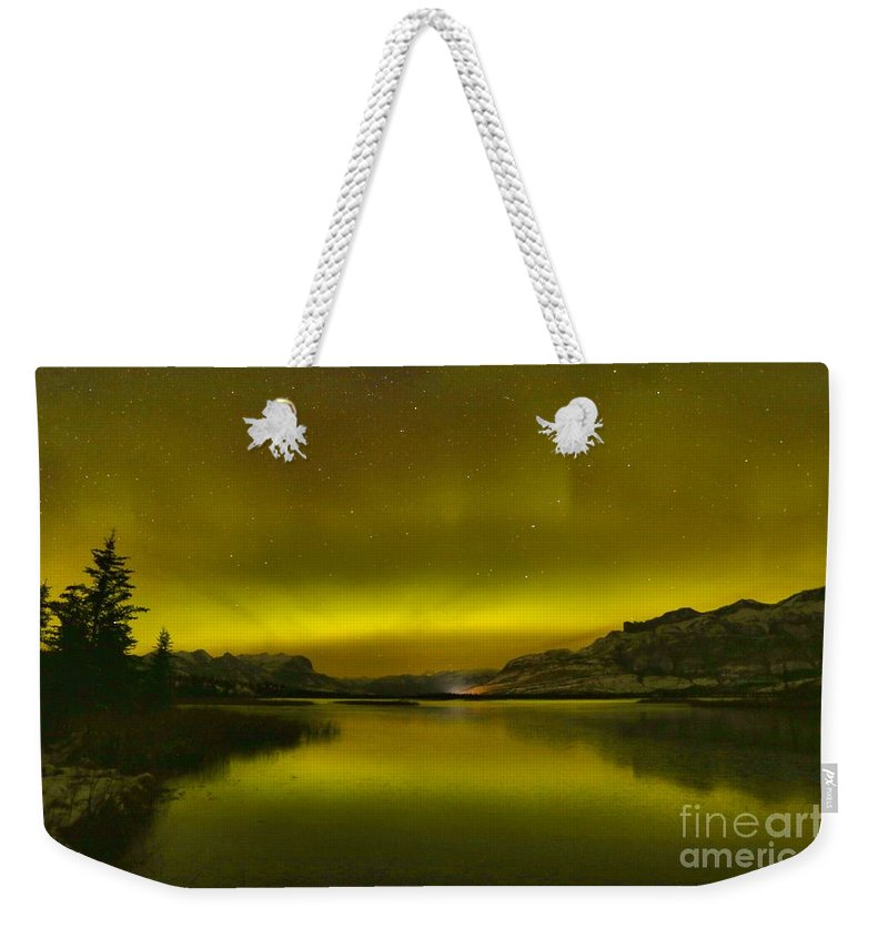 Northern Lights Weekender Tote Bag featuring the photograph Auroa Borealis At Talbot Lake by Adam Jewell