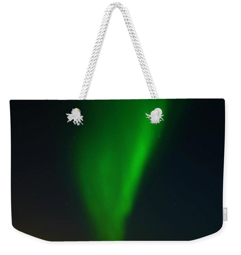 Aurora Borealis Weekender Tote Bag featuring the photograph Aurora Borealis by Anthony Jones