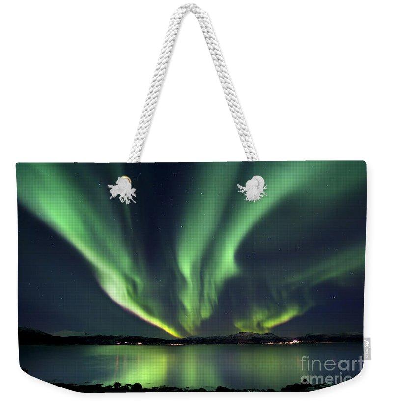 Aurora Borealis Weekender Tote Bag featuring the photograph Aurora Borealis Over Tjeldsundet by Arild Heitmann