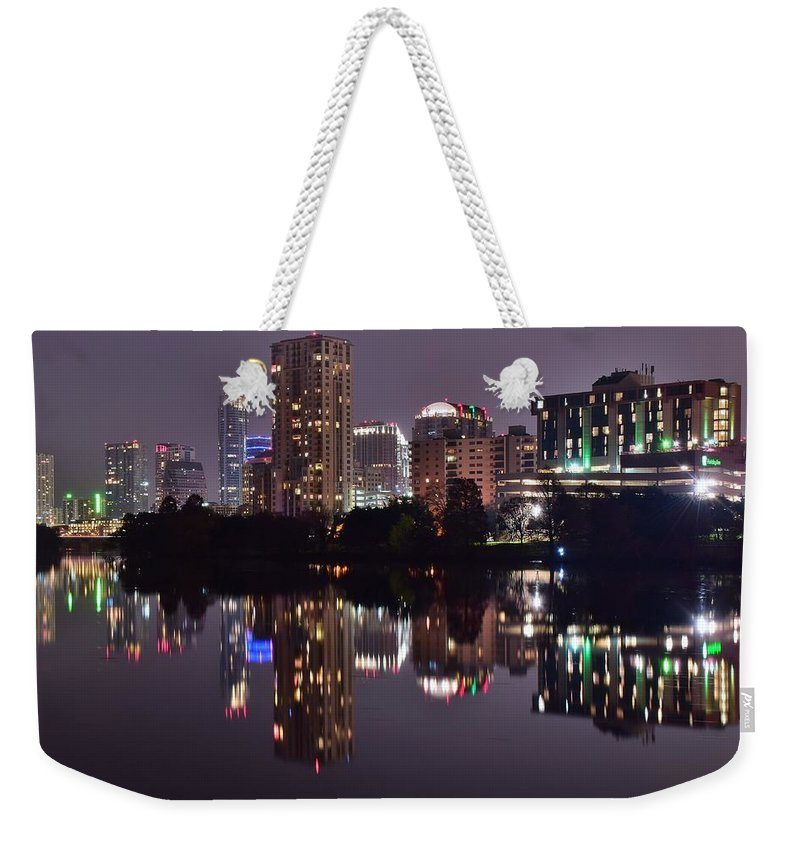 Austin Weekender Tote Bag featuring the photograph Austin Lights Up Lady Bird Lake by Frozen in Time Fine Art Photography