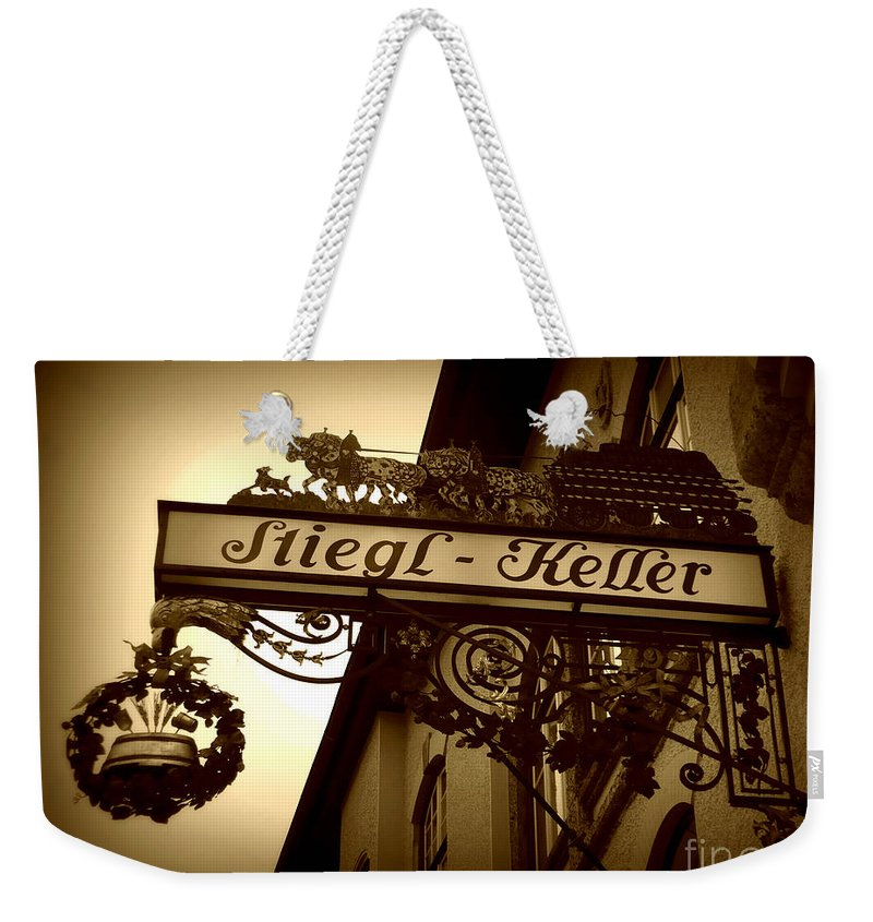 Sign Weekender Tote Bag featuring the photograph Austrian Beer Cellar Sign by Carol Groenen