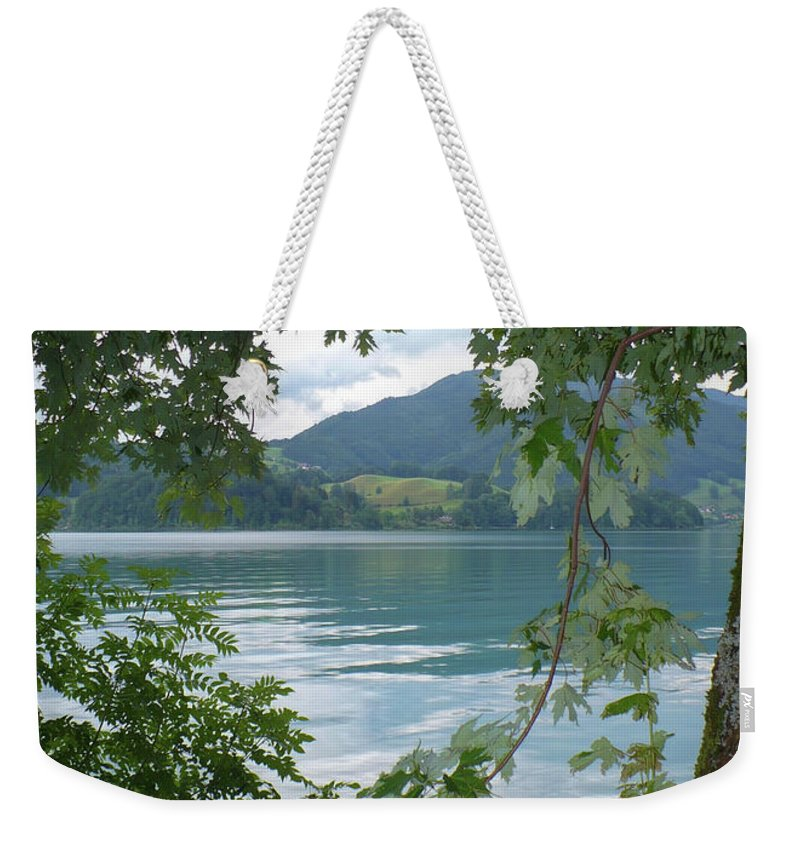 Austria Weekender Tote Bag featuring the photograph Austrian Lake Through The Trees by Carol Groenen