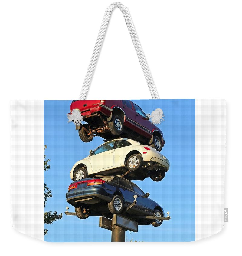 Car Weekender Tote Bag featuring the photograph Auto Pile Up by Steve Gass