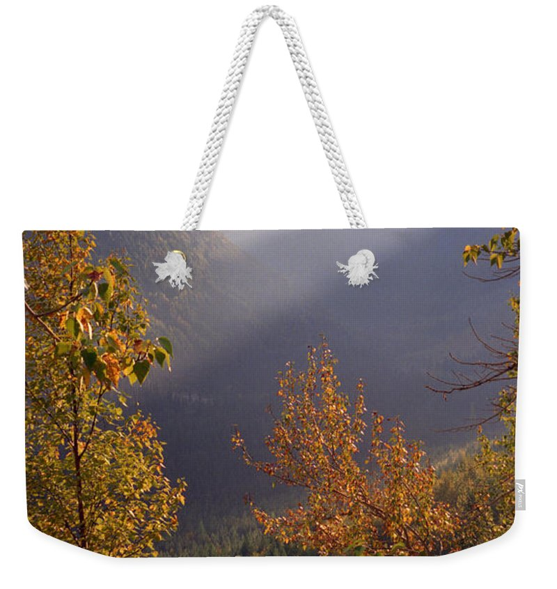 Mountains Weekender Tote Bag featuring the photograph Autumn At Logan Pass by Richard Rizzo