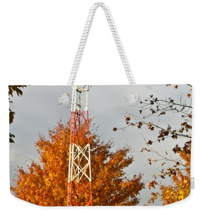 Autumn Weekender Tote Bag featuring the photograph Autumn At The Airport Light Tower by Douglas Barnett