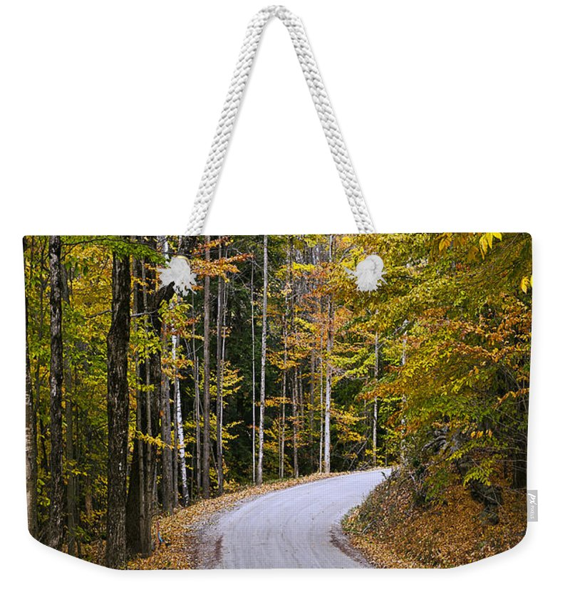New England Weekender Tote Bag featuring the photograph Autumn Country Road by John Greim