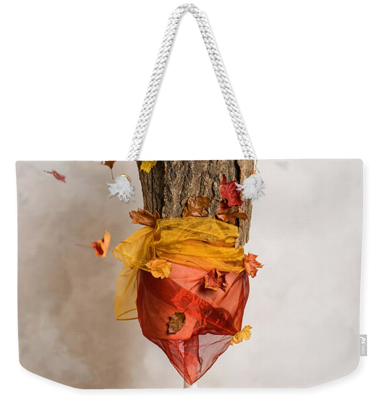Autumn Weekender Tote Bag featuring the photograph Autumn Mannequin With Falling Leaves by Amanda Elwell
