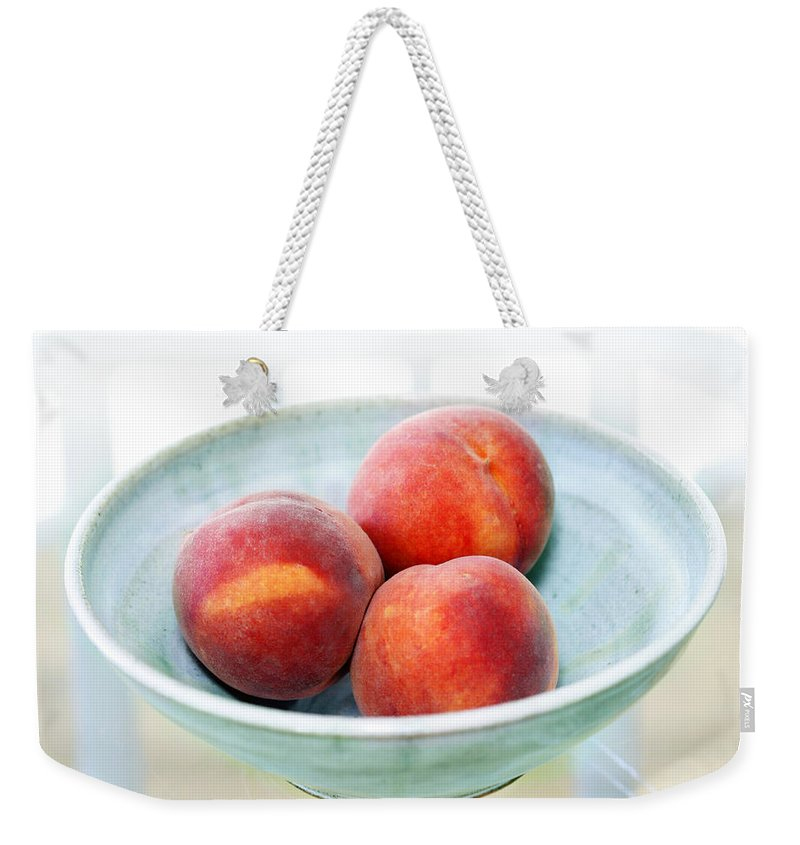 Peaches Weekender Tote Bag featuring the photograph Autumn Peaches by Marilyn Hunt