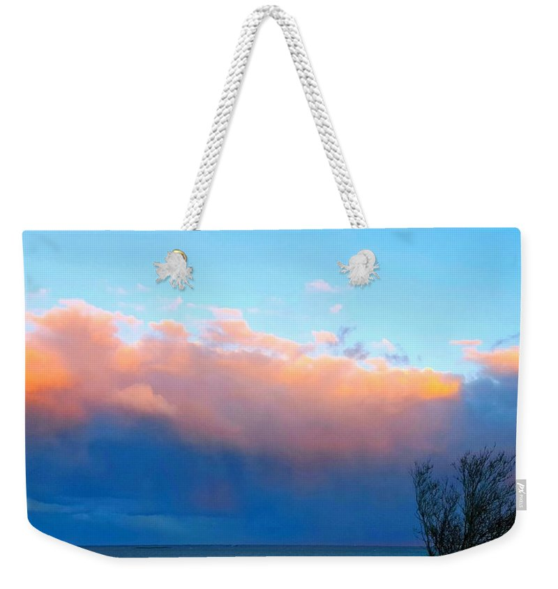 Pale Blur Skin Weekender Tote Bag featuring the photograph Autumn Storm Clouds And Sunset by Harriet Harding