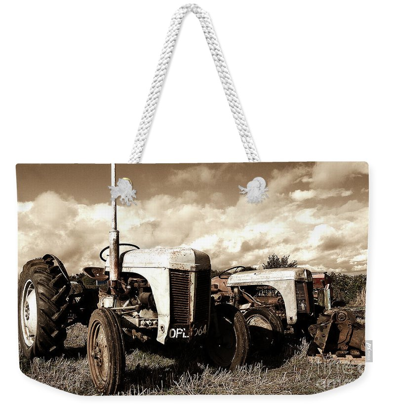 Tractor Weekender Tote Bag featuring the photograph Awaiting The Auctioneer by Rob Hawkins