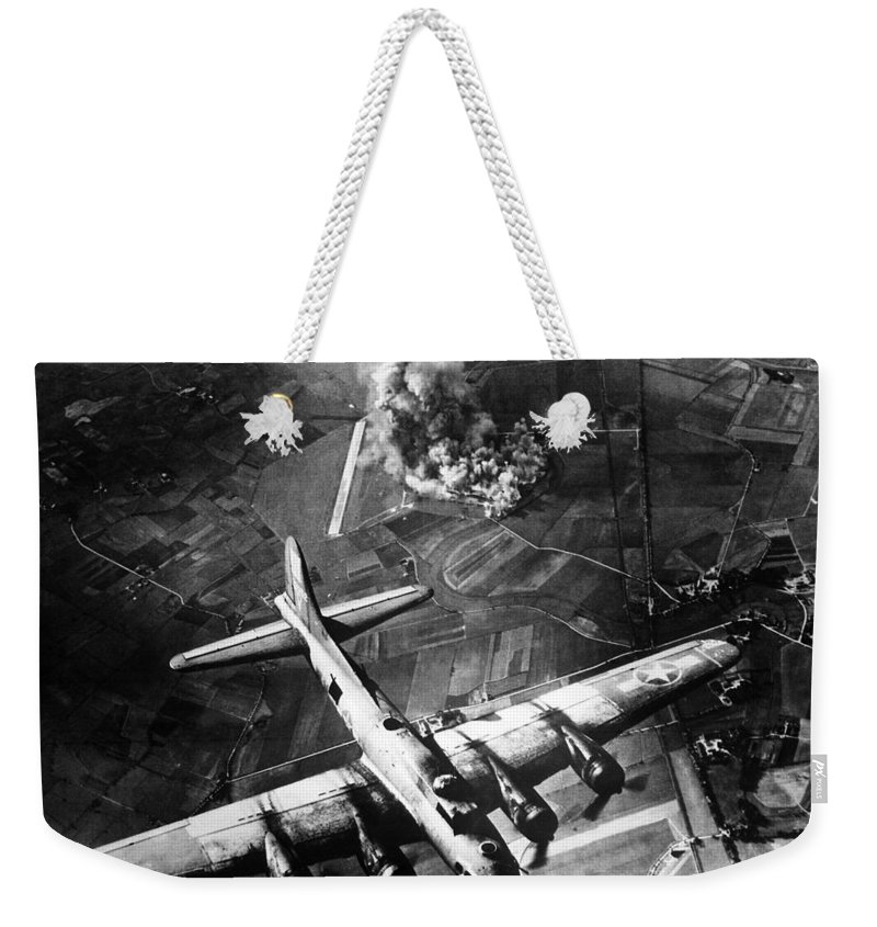 B 17 Weekender Tote Bag featuring the photograph B-17 Bomber Over Germany by War Is Hell Store